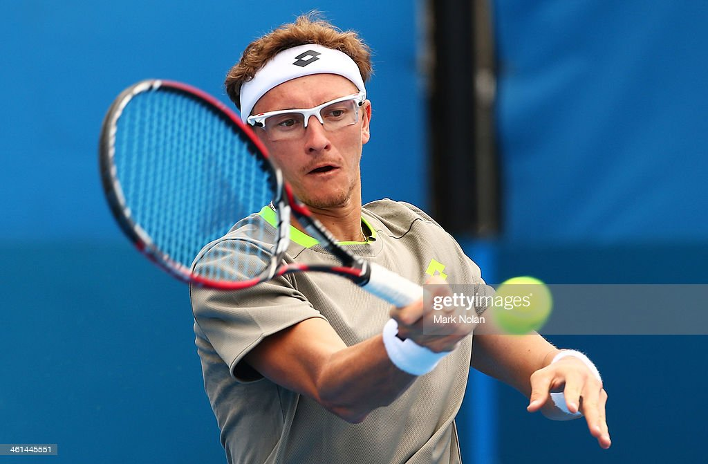 Denis Istomin of Uzbekistan plays a forehand in his match against Dmitry Tursunov of Russia during day five of the 2014 Sydney International at Sydney Olympic Park Tennis Centre on January 9, 2014 in Sydney, Australia.