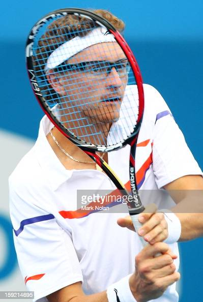 Denis Istomin of Uzbekistan plays a forehand in his quaterfinal match against Kevin Anderson of South Africa during day five of the Sydney...