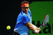 Denis Istomin of Uzbekistan plays a match against Andy Murray of Great Brittain during Day 6 of the Miami Open presented by Itau at Crandon Park...