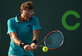 Denis Istomin of Uzbekistan plays a match against Austin Krajicek of the USA during Day 3 at the Miami Open at Crandon Park Tennis Center on March 25...