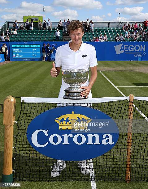 Denis Istomin of Uzbekistan poses with the trophy after victory over Sam Querrey of the United States during the mens singles final match on day...