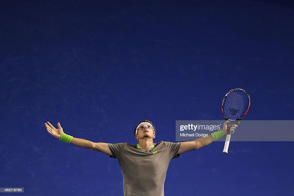 <a gi-track='captionPersonalityLinkClicked' href=/galleries/search?phrase=Denis+Istomin&family=editorial&specificpeople=553792 ng-click='$event.stopPropagation()'>Denis Istomin</a> of Uzbekistan reacts after hitting a winner in his match against <a gi-track='captionPersonalityLinkClicked' href=/galleries/search?phrase=Novak+Djokovic&family=editorial&specificpeople=588315 ng-click='$event.stopPropagation()'>Novak Djokovic</a> of Serbia during day five of the 2014 Australian Open at Melbourne Park on January 17, 2014 in Melbourne, Australia.