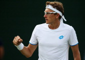 Denis Istomin of Uzbekistan reacts against Julian Reister of Germany during their Gentlemen's Singles second round match against on day four of the...