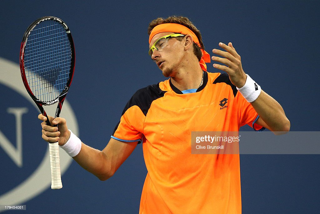 <a gi-track='captionPersonalityLinkClicked' href=/galleries/search?phrase=Denis+Istomin&family=editorial&specificpeople=553792 ng-click='$event.stopPropagation()'>Denis Istomin</a> of Uzbekistan reacts during his men's singles fourth round match against Andy Murray of Great Britain on Day Nine of the 2013 US Open at USTA Billie Jean King National Tennis Center on September 3, 2013 in the Flushing neighborhood of the Queens borough of New York City.