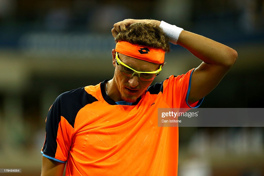 Denis Istomin of Uzbekistan reacts during his men's singles fourth round match against Andy Murray of Great Britain on Day Nine of the 2013 US Open at USTA Billie Jean King National Tennis Center on September 3, 2013 in the Flushing neighborhood of the Queens borough of New York City.