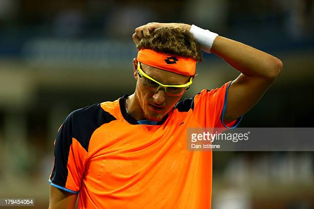 Denis Istomin of Uzbekistan reacts during his men's singles fourth round match against Andy Murray of Great Britain on Day Nine of the 2013 US Open...
