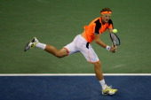 Denis Istomin of Uzbekistan returns a backhand during his men's singles fourth round match against Andy Murray of Great Britain on Day Nine of the...