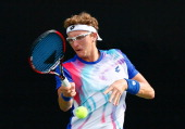 Denis Istomin of Uzbekistan returns a forehand to Lukas Lacko of Slovakia during the BBT Atlanta Open at Atlantic Station on July 23 2014 in Atlanta...