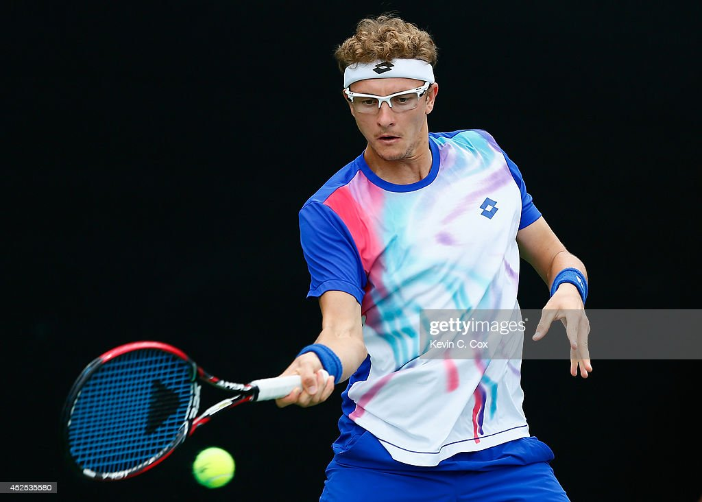 Denis Istomin of Uzbekistan returns a forehand to Rajeev Ram during the BB&T Atlanta Open at Atlantic Station on July 22, 2014 in Atlanta, Georgia.