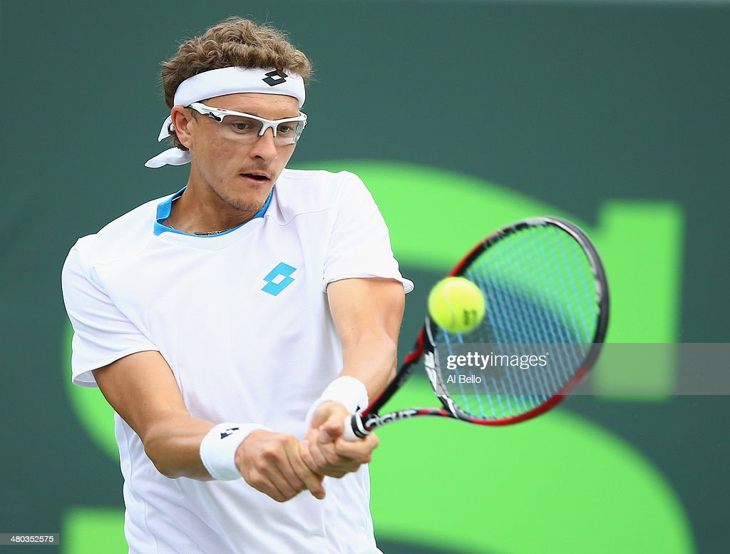 Denis Istomin of Uzbekistan returns the ball to Rafael Nadal of Spain during their match on day 8 of the Sony Open at Crandon Park Tennis Center on March 24, 2014 in Key Biscayne, Florida.