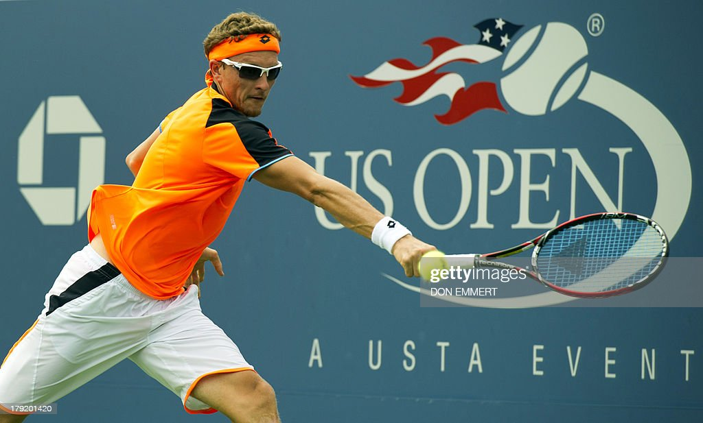 Denis Istomin of Uzbekistan returns to Andreas Seppi of Italy during their US Open 2013 men's singles match at the USTA Billie Jean King National Center September 1, 2013 in New York. AFP PHOTO/Don Emmert