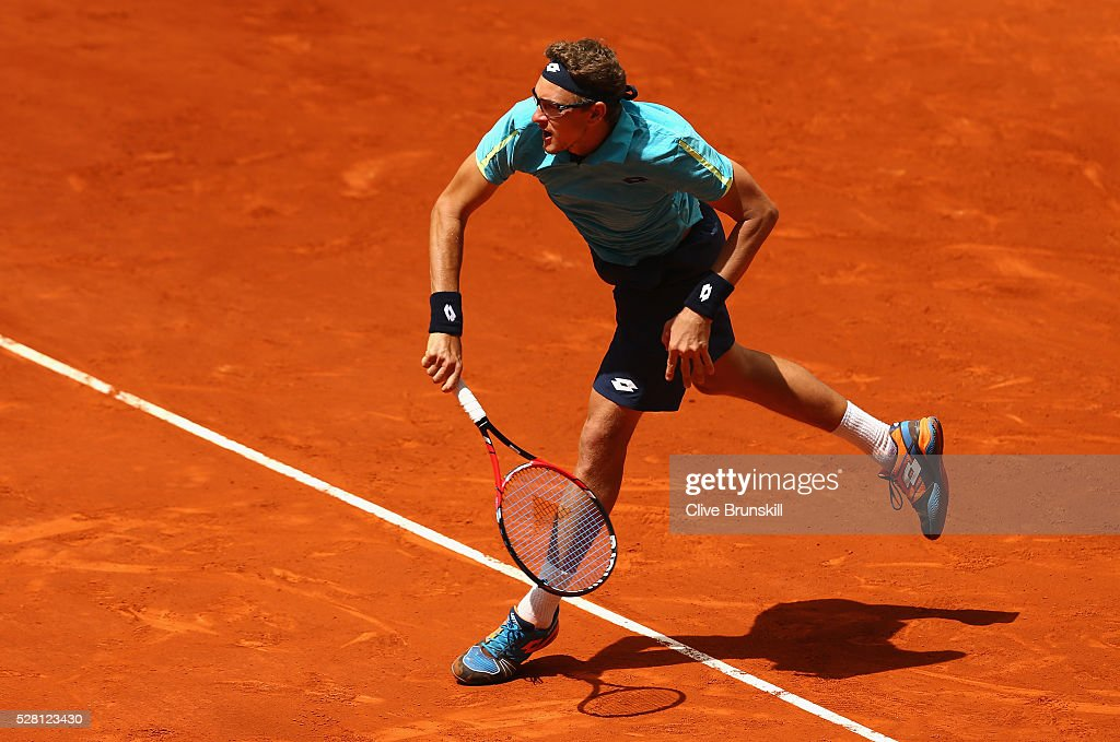 <a gi-track='captionPersonalityLinkClicked' href=/galleries/search?phrase=Denis+Istomin&family=editorial&specificpeople=553792 ng-click='$event.stopPropagation()'>Denis Istomin</a> of Uzbekistan serves against Tomas Berdych of the Czech Republic in their second round match during day five of the Mutua Madrid Open tennis tournament at the Caja Magica on May 04, 2016 in Madrid.