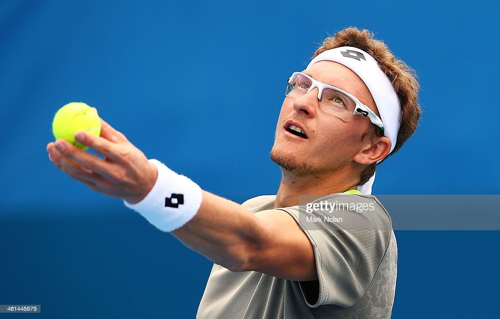 Denis Istomin of Uzbekistan serves in his match against Dmitry Tursunov of Russia during day five of the 2014 Sydney International at Sydney Olympic Park Tennis Centre on January 9, 2014 in Sydney, Australia.