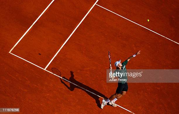 Denis Istomin of Uzbekistan serves in his match against Richard Gasquet of France during Day Two of the ATP Masters Series Tennis at the Monte Carlo...