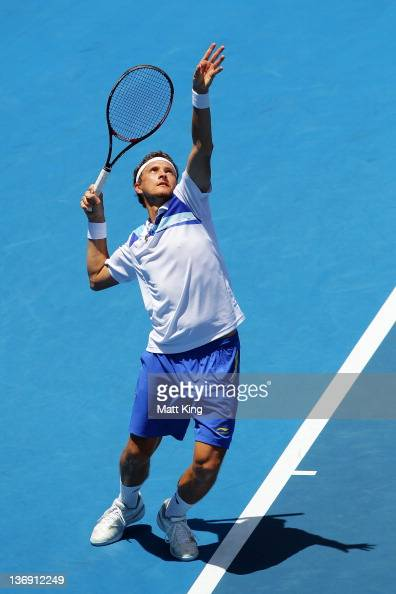Denis Istomin of Uzbekistan serves in his semi final match against Jarkko Nieminen of Finalnd during day six of the 2012 Sydney International at...