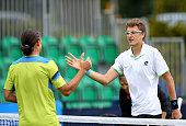 Denis Istomin of Uzbekistan shakes hands with Alexandr Dolgopolov of Ukraine after practice ahead of their semi final matches on day six of the Aegon...