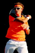 Denis Istomin of Uzebekistan returns a shot to Santiago Giraldo of Columbia during the Citi Open at the William HG FitzGerald Tennis Center on July...