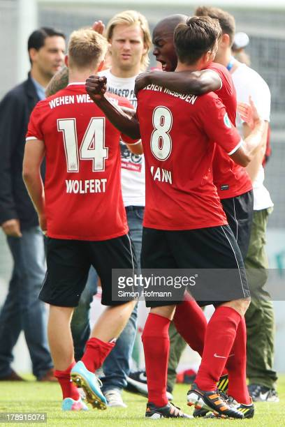 Denis Jose Pierre Vunguidica and Marcus Mann of Wiesbaden celebrate their victory after the Third Bundesliga match between SV Wehen Wiesbaden and...