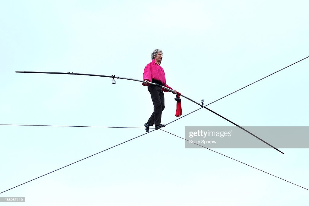 Denis Josselin during a successful attempt to cross the Seine River by tightrope on April 6, 2014 in Paris, France.Ê The 150 meter (492 feet) crossing took 30 minutes to complete.