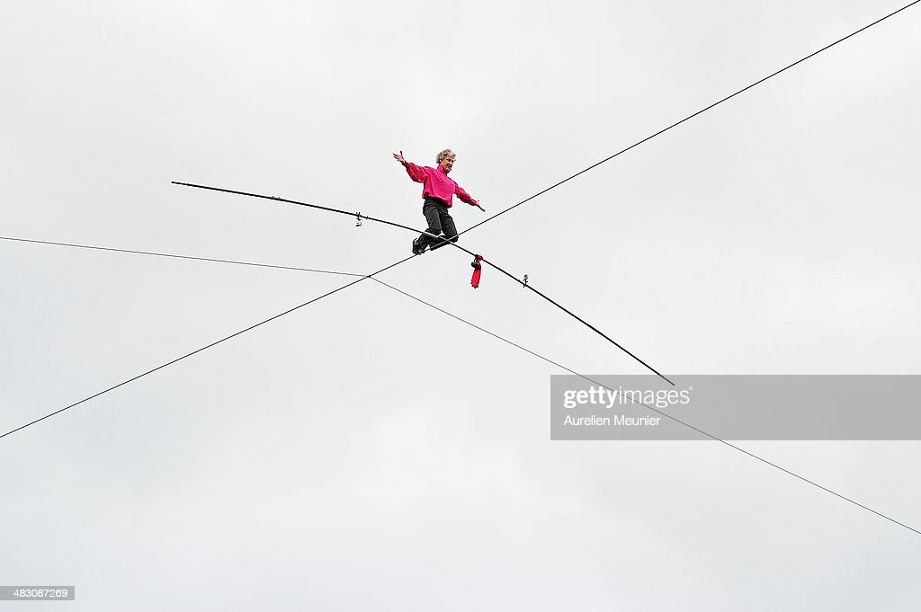 Denis Josselin during a successful attempt to cross the Seine River by tightrope on April 6, 2014 in Paris, France. The 150 meter (492 feet) crossing took 30 minutes to complete.