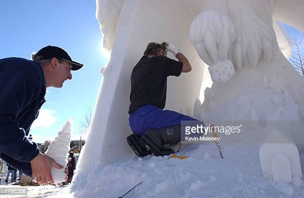 Denis Kleine and Peter Vogelaar work on their creation at the 13th annual International Snow Sculpture Championship January 31 2003 in Breckenridge...