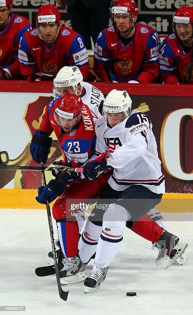 Denis Kokarev (#23) of Russia and Craig Smith (#15) of USA battle for the puck during the IIHF World Championship quarterfinal match between Russia and USA at Hartwall Areena on May 16, 2013 in Helsinki, Finland.