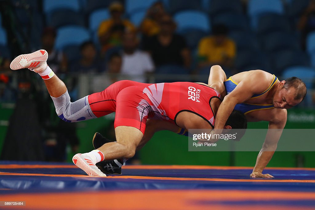Denis Kudla of Germany and Zhanarbek Kenzheev of Kyrgyzstan compete during the Men's GrecoRoman 85 kg on Day 10 of the Rio 2016 Olympic Games at...