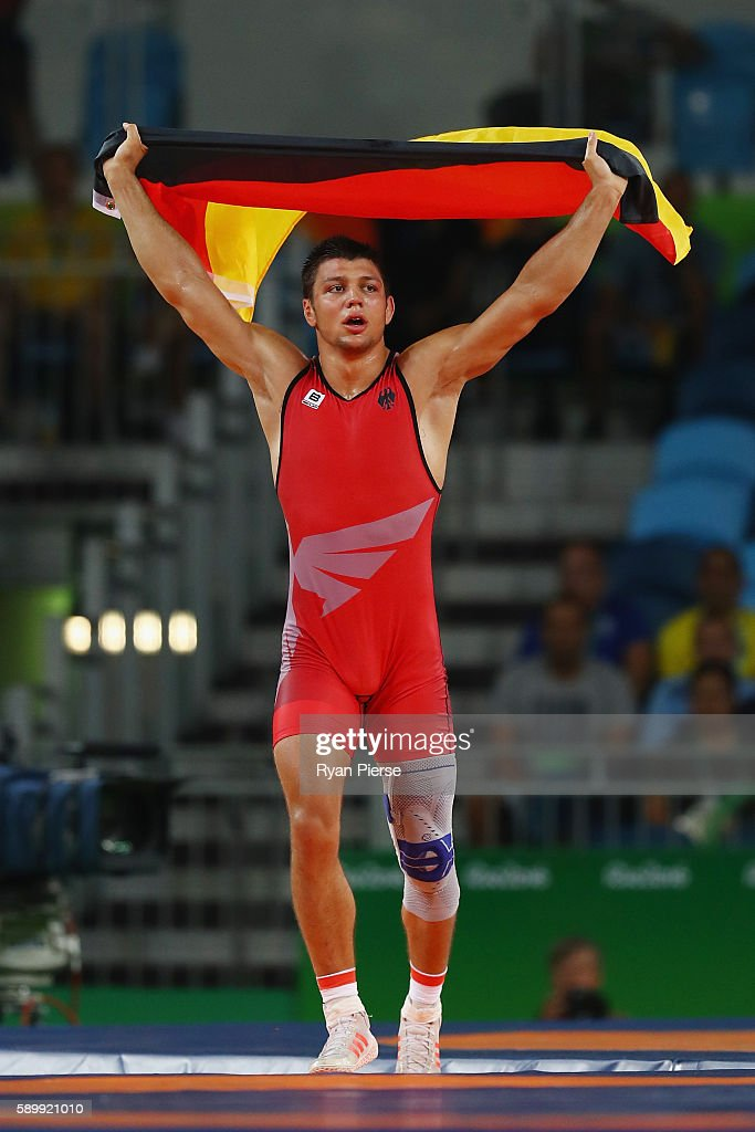 Denis Kudla of Germany celebrates victory over Viktor Lorincz of Hungary in the Men's GrecoRoman 85 kg Bronze Medal bout on Day 10 of the Rio 2016...