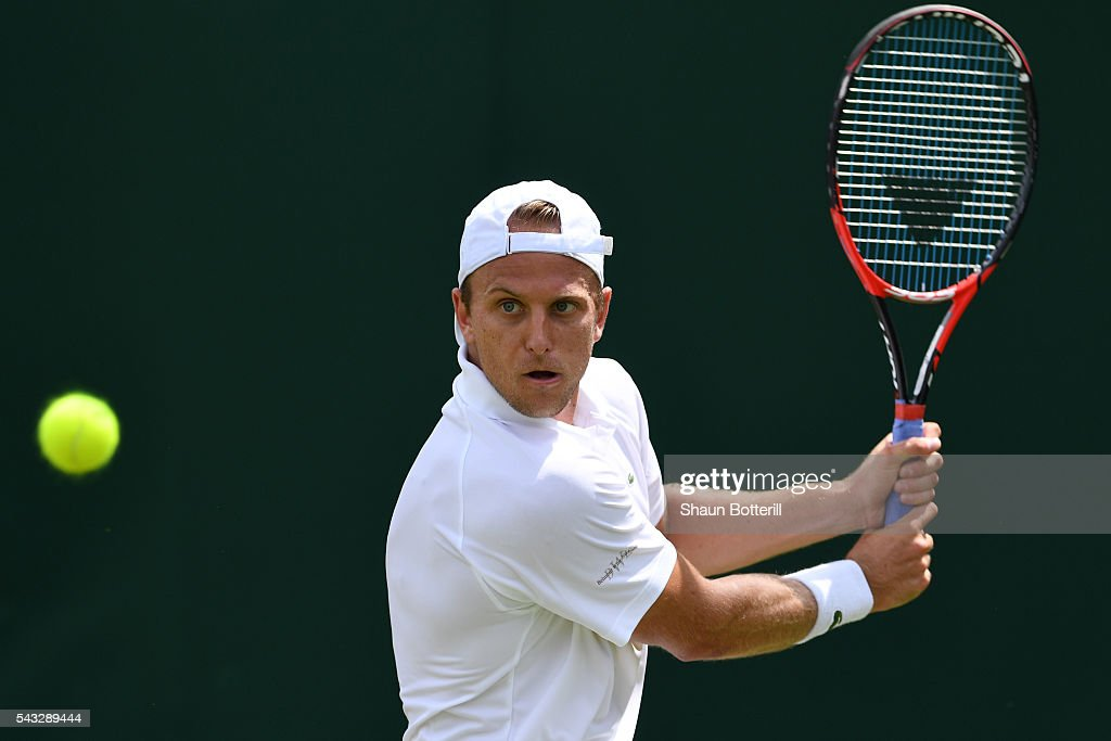 Denis Kudla of The United States plays a backhand shot during the Men's Singles first round against Damie Dzumhur of Bosnia and Herzegovina on day one of the Wimbledon Lawn Tennis Championships at the All England Lawn Tennis and Croquet Club on June 27th, 2016 in London, England.