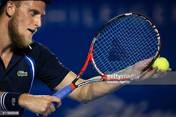 Denis Kudla of USA returns the ball to Grigor Dimitrov of Bulgaria during the match of day 2 of the Mexican Open in the Princess Hotel in Acapulco...