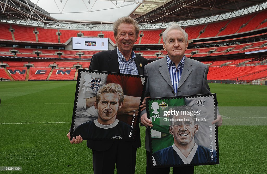 <a gi-track='captionPersonalityLinkClicked' href=/galleries/search?phrase=Denis+Law+-+Soccer+Player&family=editorial&specificpeople=15746096 ng-click='$event.stopPropagation()'>Denis Law</a> and <a gi-track='captionPersonalityLinkClicked' href=/galleries/search?phrase=Dave+Mackay+-+Soccer+Player+-+Born+1934&family=editorial&specificpeople=14013516 ng-click='$event.stopPropagation()'>Dave Mackay</a> pose for the camera with their stamps during the Royal Mail Stamp Launch at Wembley Stadium on May 8, 2013 in London, England.