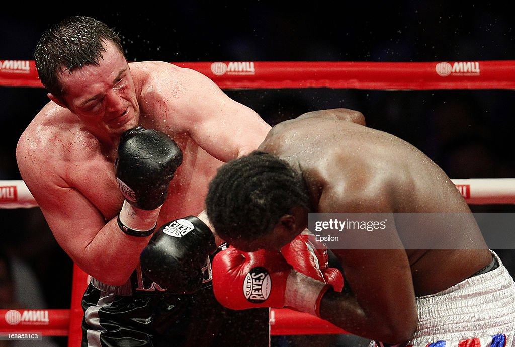 Denis Lebedev (L) of Russia fights with Guillermo Jones of Panama during their WBA cruiserweight title bout at the Crocus City Hall on May 17, 2013 in Moscow, Russia.