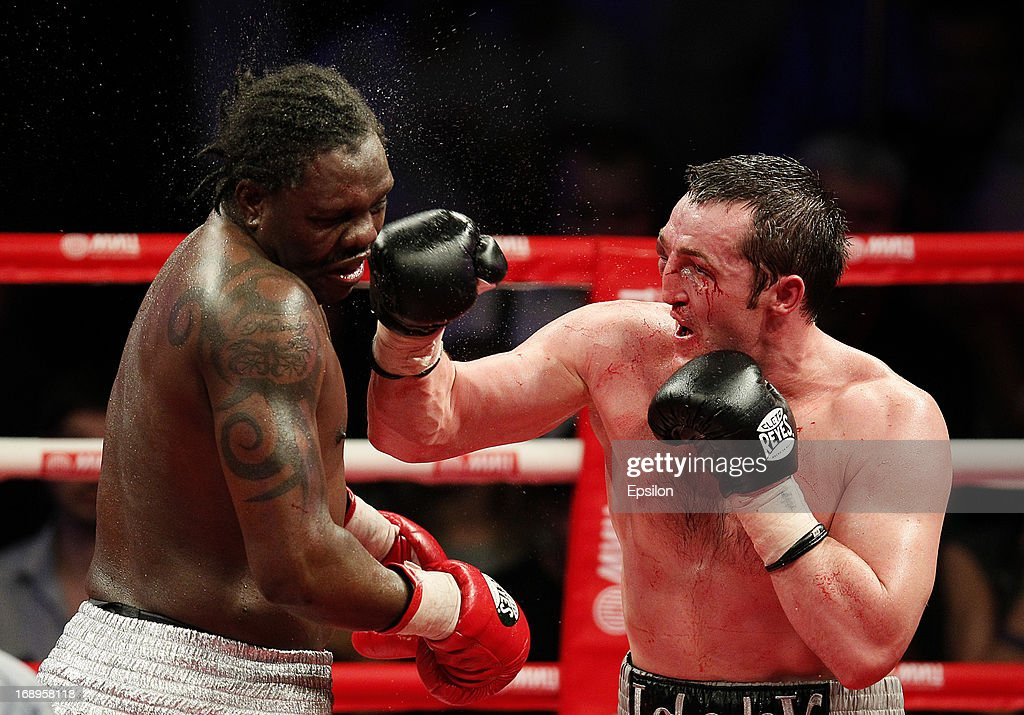Denis Lebedev (R) of Russia fights with Guillermo Jones of Panama during their WBA cruiserweight title bout at the Crocus City Hall on May 17, 2013 in Moscow, Russia.
