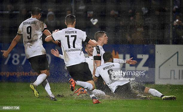 Denis Linsmayer of Sandhausen celebrates with his teammates after scoring his team's first goal during the Second Bundesliga match between SV...
