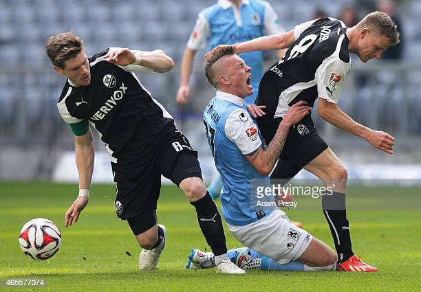 Denis Linsmayer of SV Sandhausen fouls Marius Wolf of 1860 Muenchen during the 2 Bundesliga match between 1860 Muenchen and SV Sandhausen on March 8...