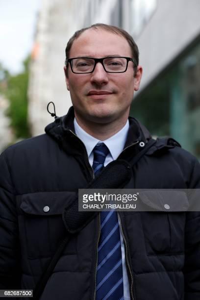 Denis Massiglia candidate in the Maine et Loire 6 constituency for the party La Republique en Marche poses at the entrance of the Quai Branly museum...
