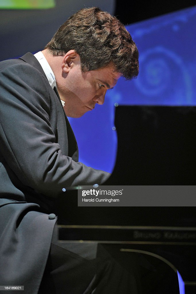 Denis Matsuev performs during the Fundamental Physics Prize Foundation Inaugural Prize Ceremony at the CICG on March 20, 2013 in Geneva, Switzerland. The prize is today the most financially lucrative scientific prize in the world, with its nine Inaugural recipients to receive 27 million USD collectively, providing them more freedom and opportunity to pursue future accomplishment. Led by a not-for-profit corporation, the Fundamental Physics Prize Foundation dedicates itself to advance the knowledge of the Universe at the deepest level.