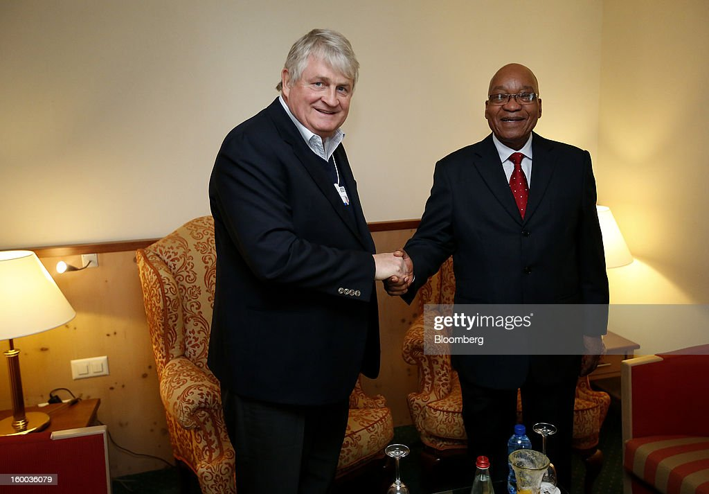 Denis O'Brien, Irish billionaire and chairman of Digicel Group Ltd., left, greets Jacob Zuma, president of South Africa, during a private meeting at the Hotel Seehoff on day three of the World Economic Forum (WEF) in Davos, Switzerland, on Friday, Jan. 25, 2013. World leaders, influential executives, bankers and policy makers attend the 43rd annual meeting of the World Economic Forum in Davos, the five day event runs from Jan. 23-27. Photographer: Jason Alden/Bloomberg via Getty Images