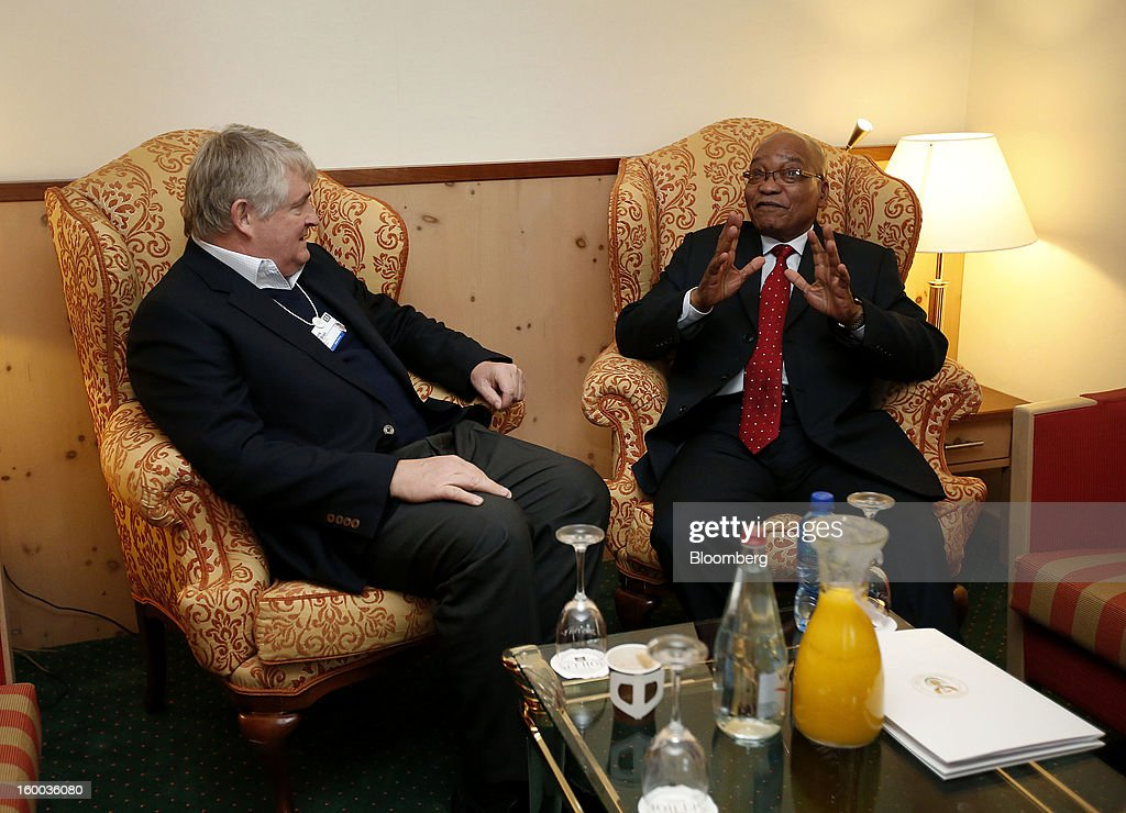 Denis O'Brien, Irish billionaire and chairman of Digicel Group Ltd., left, speaks with Jacob Zuma, president of South Africa, during a private meeting at the Hotel Seehoff on day three of the World Economic Forum (WEF) in Davos, Switzerland, on Friday, Jan. 25, 2013. World leaders, influential executives, bankers and policy makers attend the 43rd annual meeting of the World Economic Forum in Davos, the five day event runs from Jan. 23-27. Photographer: Jason Alden/Bloomberg via Getty Images