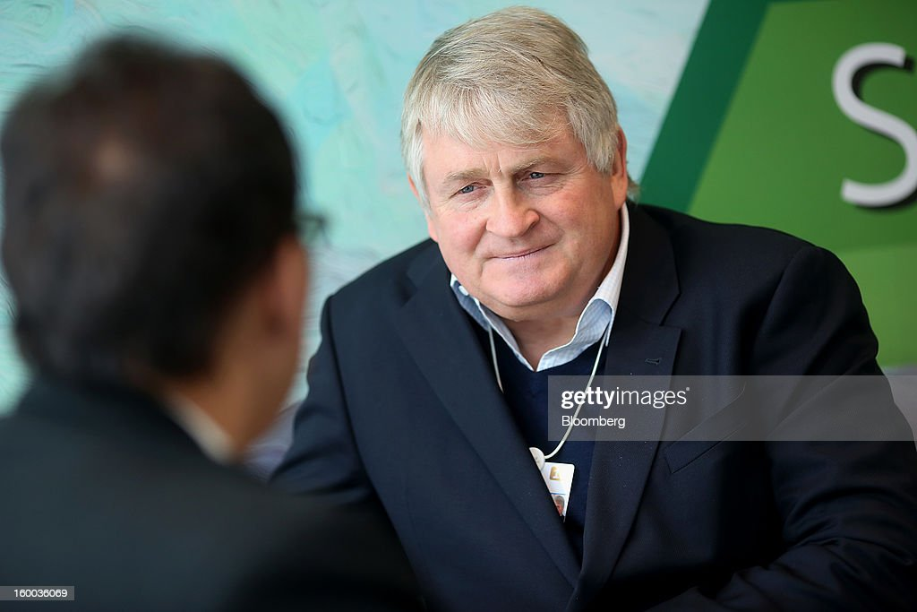 Denis O'Brien, Irish billionaire and chairman of Digicel Group Ltd., right, speaks to Jacob Zuma's aide ahead of a private meeting with the South African president at the Hotel Seehoff on day three of the World Economic Forum (WEF) in Davos, Switzerland, on Friday, Jan. 25, 2013. World leaders, influential executives, bankers and policy makers attend the 43rd annual meeting of the World Economic Forum in Davos, the five day event runs from Jan. 23-27. Photographer: Jason Alden/Bloomberg via Getty Images