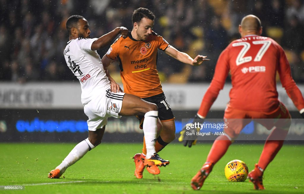 Denis Odoi of Fulham and Diogo Jota of Wolverhampton Wanderers during the Sky Bet Championship match between Wolverhampton and Fulham at Molineux on November 3, 2017 in Wolverhampton, England.
