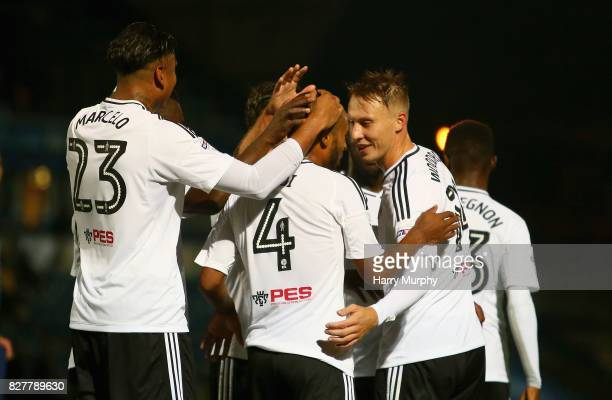 Denis Odoi of Fulham celebrates scoring his teams second goal with teammates during the Carabao Cup First Round match between Wycombe Wanderers and...