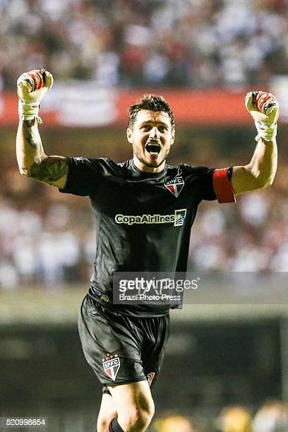 Denis of Sao Paulo celebrates the opening goal scored by his teammate Jonathan Calleri during a match between Sao Paulo and River Plate as part of...