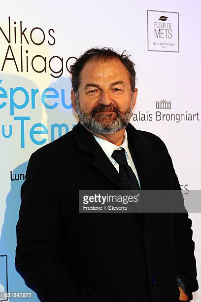 Denis Olivennes poses during the exhibition of TV and radio presenter Nikos Aliagas attends his The exhibition 'The Test of Time' at Palais...