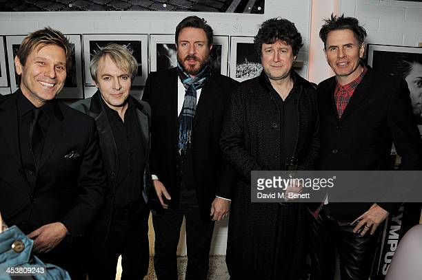 Denis O'Regan poses with Roger Taylor Nick Rhodes Simon Le Bon and John Taylor of Duran Duran attend the launch of new book 'Duran Duran Denis...