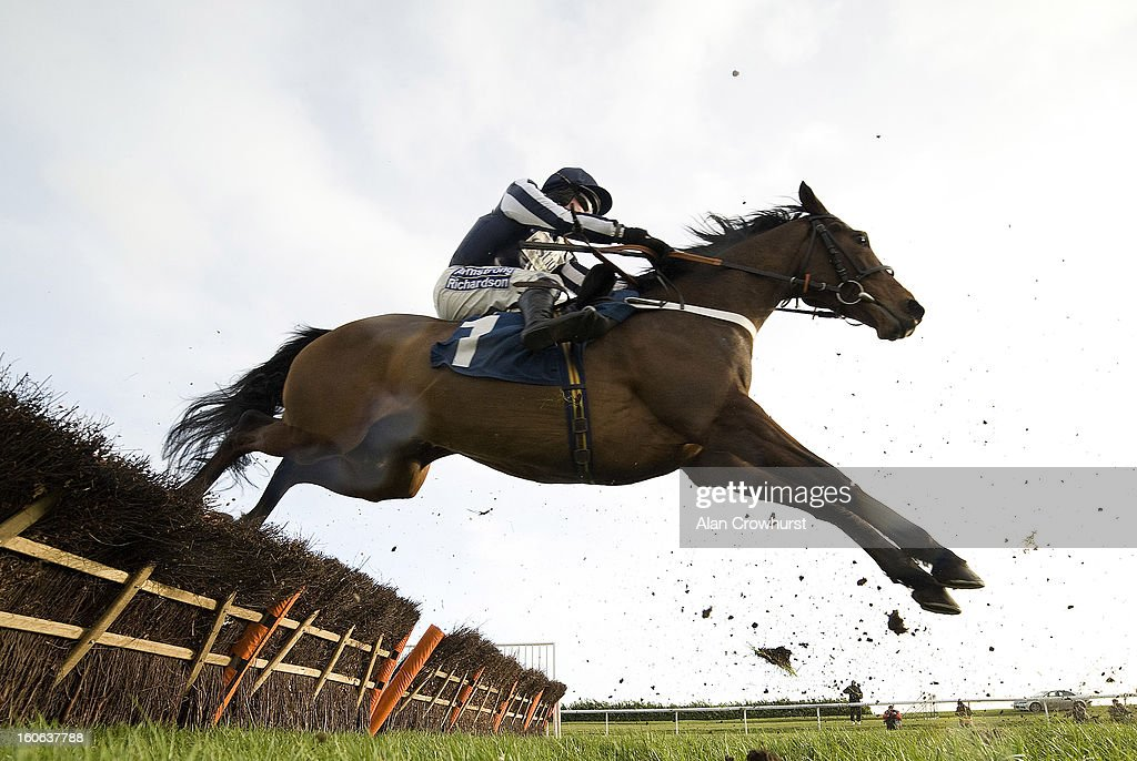 Denis O'Regan riding Countrywide Flame in The 32Red Hurdle Race at Doncaster racecourse on February 04, 2013 in Doncaster, England.