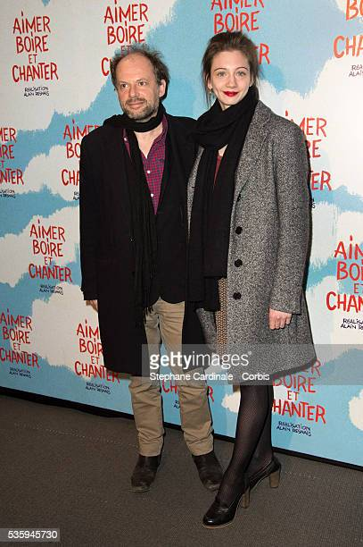 Denis Podalydes and guest attend the premiere of 'Aimer Boire et Chanter' in Paris