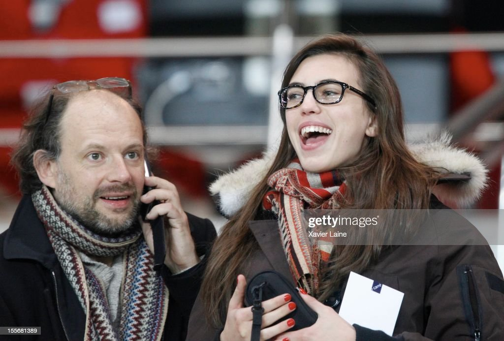 Denis Podalydes and his new girlfriend attend the UEFA Champions League between Paris Saint Germain and GNK Dinamo Zagreb at Parc Des Princes on November 06, 2012 in Paris, France.