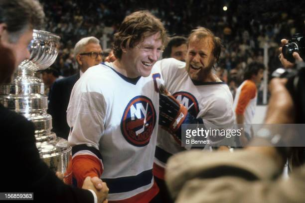 Denis Potvin and Butch Goring of the New York Islanders celebrate after they defeated the Minnesota North Stars in Game 5 of the 1981 Stanley Cup...
