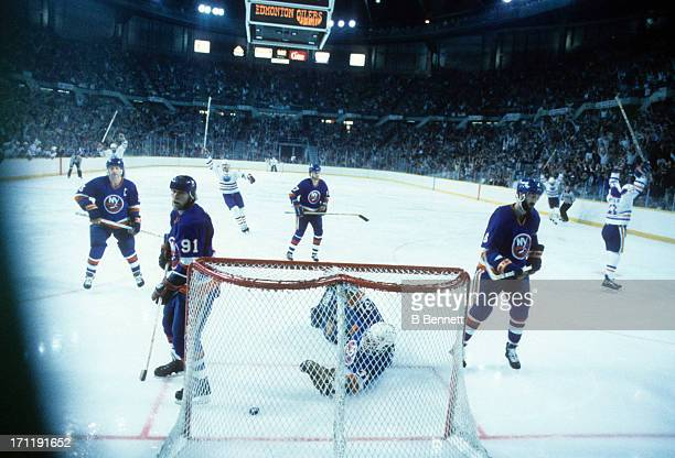 Denis Potvin Ken Morrow Butch Goring Greg Gilbert and goalie Billy Smith of the New York Islanders look defected after giving up a goal during the...